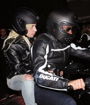 Lady Gaga joined Bradley Cooper for a bike ride wearing a Harley Davidson helmet.