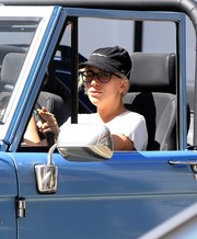 Lady Gaga kept the sun out with a black baseball cap by Thread Workshop while cruising in Beverly Hills.