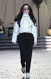 Lady Gaga rocked a more minimal look — for her at least! — when she stepped out in this crackled-paint turtleneck.