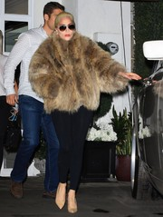 Lady Gaga sealed off her look with nude pumps by Brian Atwood.