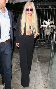 Lady Gaga grabbed dinner in Beverly Hills looking sultry in a black Alice + Olivia pantsuit and a matching bra.