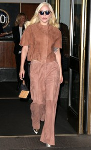 Lady Gaga stepped out of her NYC hotel wearing a boxy brown top by Hektor.