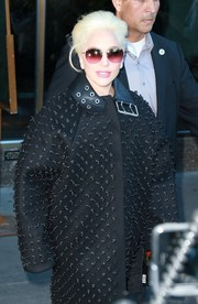 Lady Gaga looked striking wearing raspberry-hued Barton Perreira sunglasses and a studded coat while out in New York City.