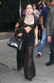 Lady Gaga flashed plenty of flesh in a sheer black Fleur du Mal jumpsuit with an open front while out and about in New York City.