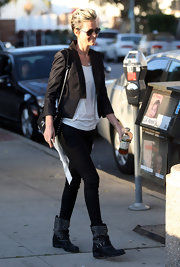 Laeticia strolled through Santa Monica in black studded motorcycle boots.