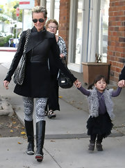 We love Laeticia's print leggings with this black ensemble.