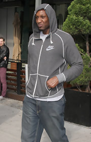 Lamar Odom tried to go incognito in a gray Nike hoodie as he was leaving his hotel in NYC.