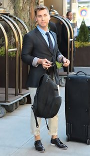 Lance Bass chose a sleek and dapper daytime look with this charcoal gray blazer paired over a blue button down.