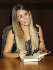Lauren Conrad wore her blond ombre locks in a sleek 'do.