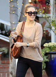 Lauren Conrad punctuated her all black attire with a sheer tan sweater.