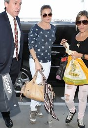 LeAnn looked totally classic and preppy in this navy sweatshirt with white stars while out in LA.