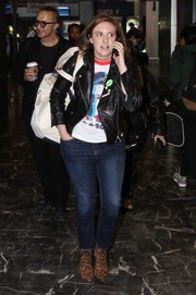 Lena Dunham layered a black biker jacket over her T-shirt for a cool finish.