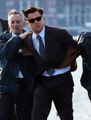 Leonardo DiCaprio was costumed in a suit and a polka-dot tie for his new film 'The Wolf of Wall Street.'