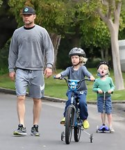 Liev Schrieber chose a gray sweatshirt printed with 'Love' in sign language for his daytime look while out with his sons.
