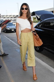 Lily Aldridge completed her head-turning airport ensemble with a pair of camel-colored cross-strap slide sandals.