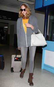 Lily Cole looked grungy in her old brown lace-up boots as she arrived in LA.