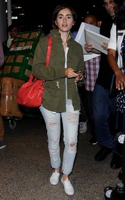 Lily Collins kept her feet comfy in white canvas sneakers by Keds