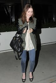 Lily Collins wore a pair of skinny blue jeans while dining out in LA.