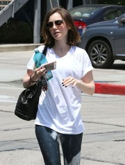 Lily Collins stepped out in West Hollywood sporting a pair of classic aviator shades.