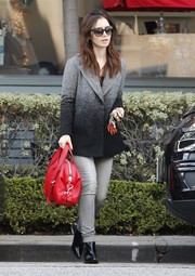 Lily Collins stuck to a monochromatic black and gray look in her ombre wool coat while shopping in West Hollywood.