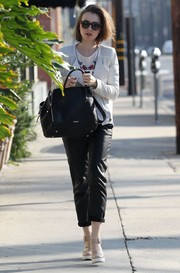 For her arm candy, Lily Collins picked the Rebecca Minkoff Perry croc-embossed tote, in black.