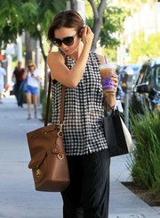 Lily Collins was spotted out in Beverly Hills carrying a tan Ralph Lauren Ricky bucket bag.