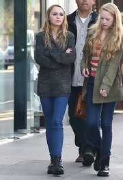 Lily-Rose Depp opted for an oversized gray cardigan for her casual look while out with friends.