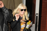 Troubled actress Lindsay Lohan leaves her downtown hotel to rehearse for