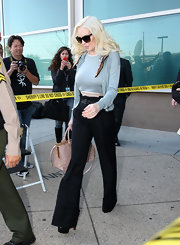 Lindsay Lohan kept her court look toned down in a pair of high-waist flares and a demure twin set.