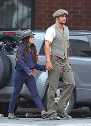Lisa Bonet took a stroll in New York City wearing a blue pantsuit, a gray hat, and round sunnies.
