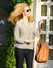 Lisa Kudrow looked all set for a relaxing day in a light print blouse and jeans.