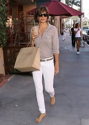 Lisa Rinna's skinny white jeans looked crisp and sleek when paired with a basic button down and sandals.