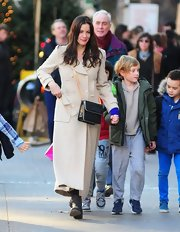 Liv walked her kids home from school in this ultra-warm and chic ankle-length camel coat.
