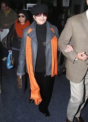 Liza Minelli arrived at LAX wearing a gray leather jacket.