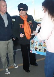Liza Minnelli was seen at LAX in a relaxed ensemble featuring an orange scarf.