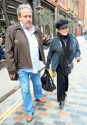 Liza Minnelli was spotted out in London carrying a couple of purses including a black patent tote.