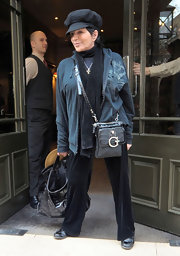 Liza Minnelli was seen outside her London hotel wearing a layer of long sleeve pieces and a scarf to keep her warm.