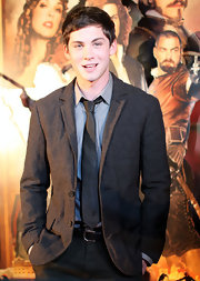 Logan Lerman's charcoal tweed jacket at the premiere of 'The Three Musketeers' had a preppy feel.