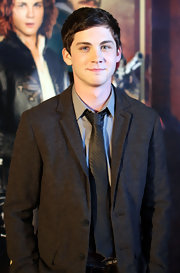 Logan Lerman completed his ensemble with an elegant striped silk tie at the premiere of 'The Three Musketeers.'