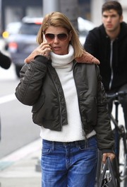 Lori Loughlin kept warm with a white turtleneck layered under a gray bomber.