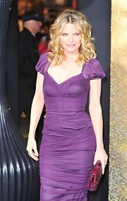Michelle Pfeiffer accented her jewel-toned dress with a stunning pink and purple snakeskin clutch.