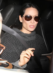 Lucy Liu kept things classic with gold aviators and big diamond studs.
