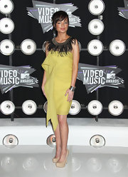 Ashley was fabulously feathered at the VMAs in a yellow dress with a feather neckline.