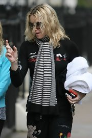 Madonna wore a long striped scarf to stay warm for her trip to the gym.