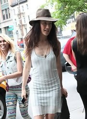 Maggie Q wore a brown fedora with her tank dress for a fun finish while out and about in New York City.