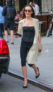 Maggie Q looked alluring on the streets of New York in a strapless black corset top.
