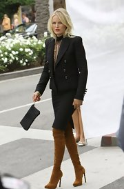 Malin looked high-fashion chic in this two-piece, double-breasted skirt suit while on a photo shoot in Beverly Hills.