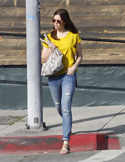Mandy Moore kept her style relaxed with distressed skinny jeans and flat tan sandals.