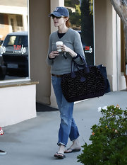 Marcia Cross was out and about in Brentwood looking casual cool in her cuffed jeans, grey sweater and Yankees baseball cap. She added a purple printed tote bag while sipping her Starbucks coffee.