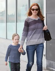 Marcia looked cute and casual in a multi-stripe V-neck sweater.